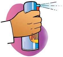 A teacher depressing the trigger on a can of compressed air