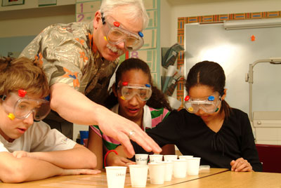 An instructor shows students how to setup an experiment to identify the identity of a liquid unknown